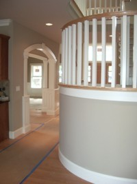 Custom Home Remodeling round staircase landing
